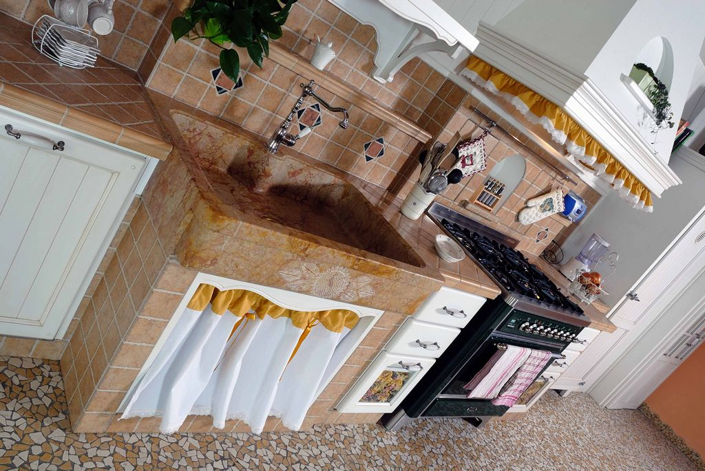 Cucina in muratura girasole con gres porcellanato contado